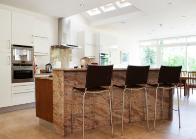 Modern Contemporary Kitchens Terenure, Dublin. The curve of the island takes full view of the garder.